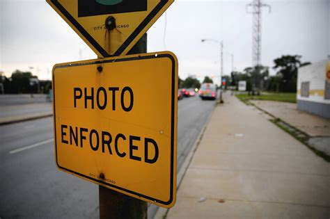 chicago red light ticket refund key red light camera player cooperating with feds