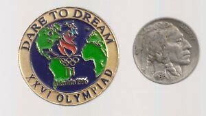 The men's national basketball team of the united states won the gold medal at the 1996 summer olympics in atlanta, georgia. 1996 Atlanta Olympic Pin Dare To Dream World Globe Normal ...