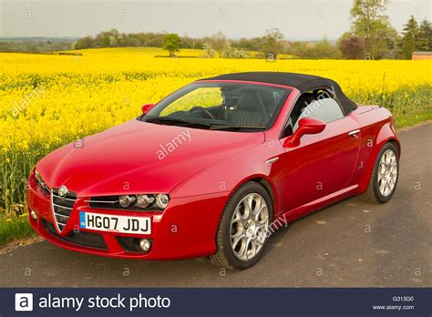 Alfa Romeo Spider Soft Top Convertible Sports Car In Red