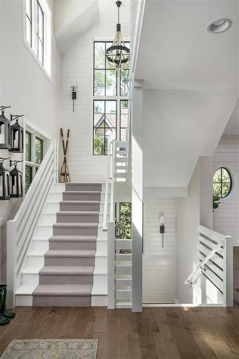 white cottage staircase  lanterns hanging  hooks