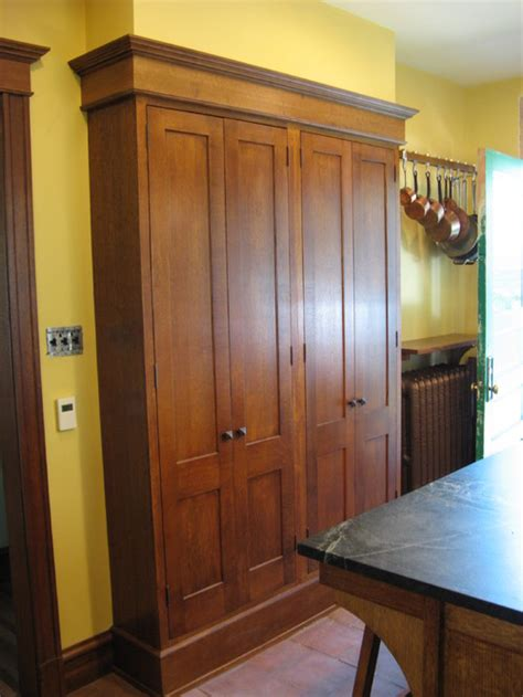 floor to ceiling kitchen cabinets what is being stored behind the tall floor to ceiling wall