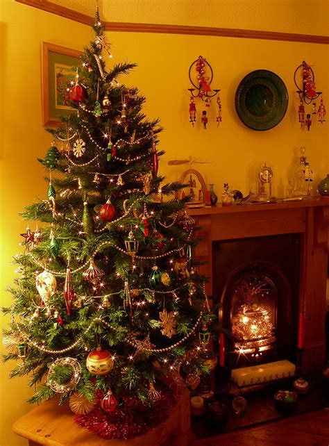 christmas tree by the fireplace pictures photos and
