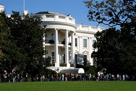 White House Fall Garden Tour visitors to the white house walk past the white house