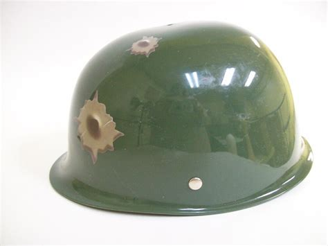 child green army helmet hat  bullet holes military