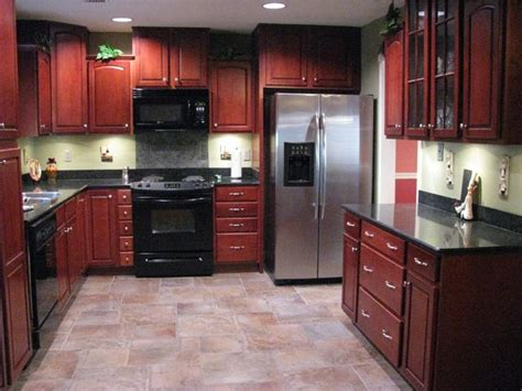 Kitchen Floor Ideas With Cherry Cabinets by Porcelain Tile Plank Floors With Cherry Cabinets Been