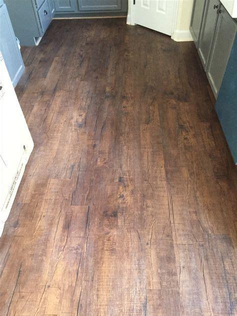 mohawk luxury vinyl plank  chocolate barnwood home