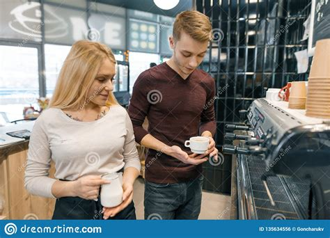We roast a couple of times per week as needed so your order is always fresh. Couple Of Young Male And Female Coffee Shop Owners Near The Counter, Talking And Smiling, Coffee ...