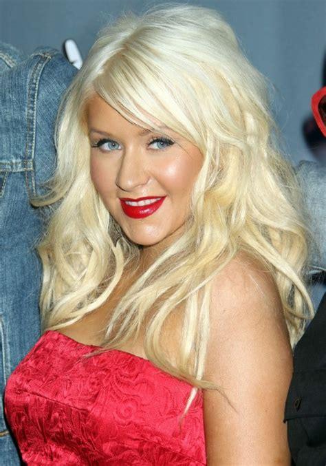 christina aguilera long blonde wavy hairstyle  bangs