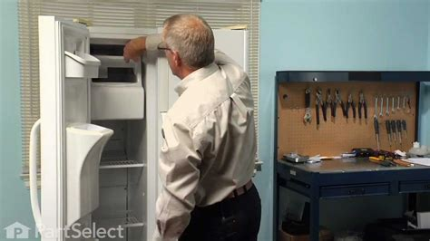 refrigerator repair replacing  ice container assembly
