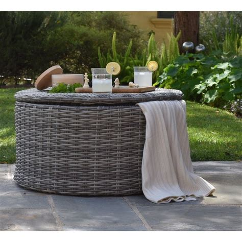 Keep these side tables with storage poolside—they're ideal for stashing extra towels, sunscreen and water use patio side tables to amp up your outdoor decor. Shop Elle Vallauris Grey Wicker Outdoor Storage Coffee ...