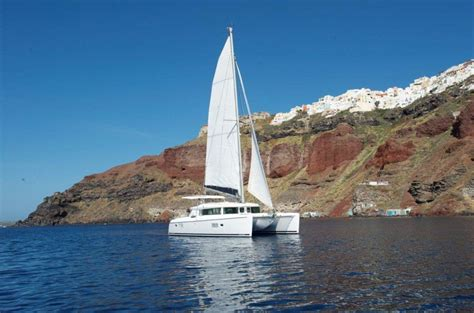 Catamaran Sailing In Santorini by Santorini Catamaran And Sailing