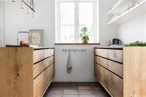 'Model Dinesen' bespoke wooden kitchen with steel tabletop