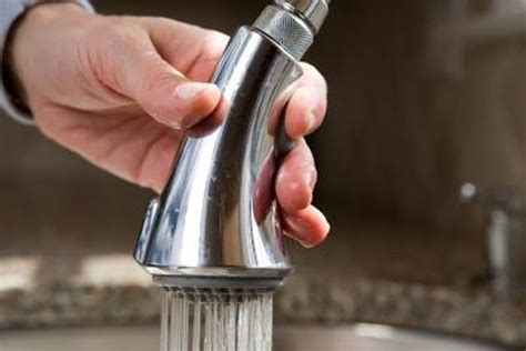 How to Clean a Pull Down Kitchen Faucet Spray Head   Hunker