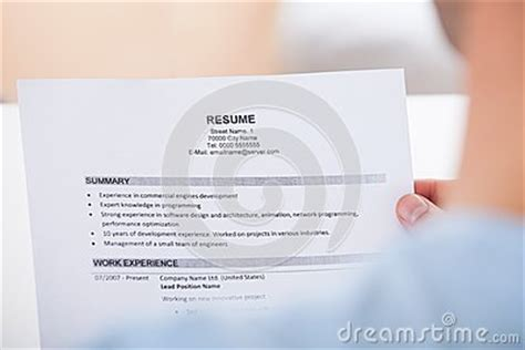 Handing Resume In Person by Person Holding Resume Stock Photo Image 47177027