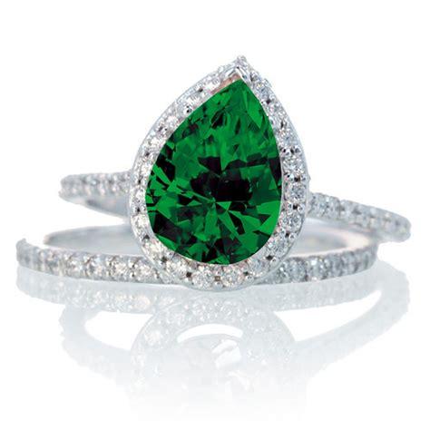 carat pear cut emerald halo bridal set  woman