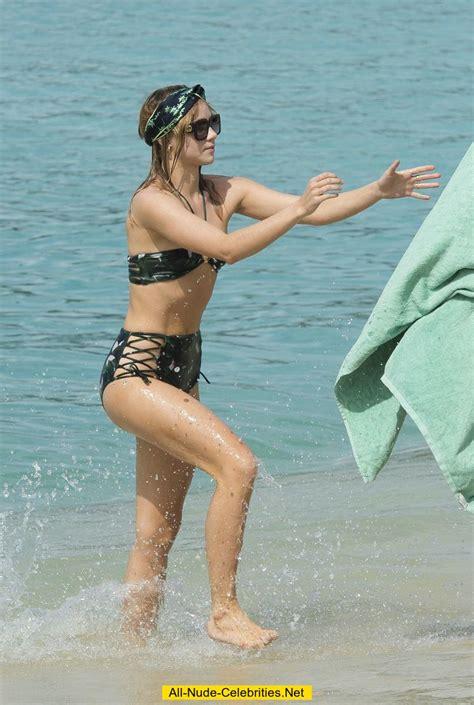 Suki Waterhouse in bikini on a beach in Barbados