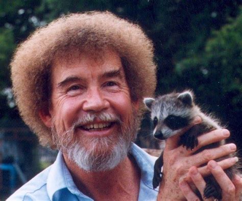 Feeling A Little Down? Here's Bob Ross With A Baby Raccoon