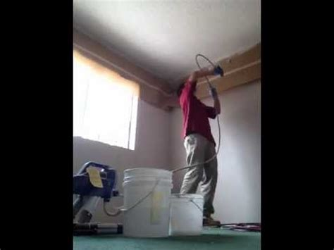 Using A Paint Sprayer For Ceilings by Spray Painting A Popcorn Ceiling