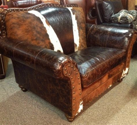 cowhide and leather chair and a half western chair