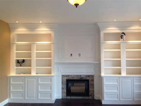 gas fireplace with built in cabinets custom full wall built in bookcases with tv mount over