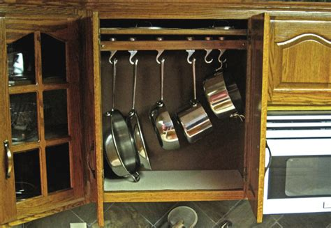kitchen storage cabinets for pots and pans picture of hooks in cabinets