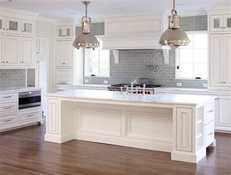gray tile with white cabinets; tile all the way up to