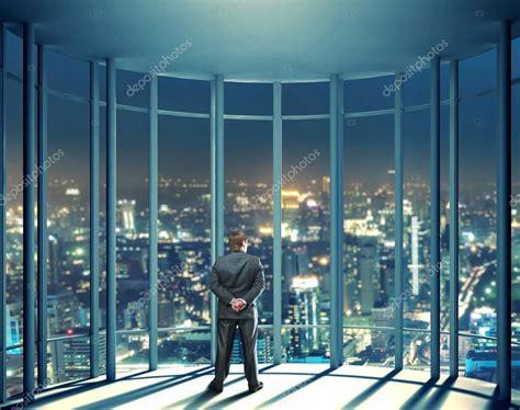 Man Looking Through Glass Window
