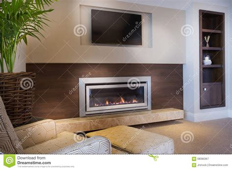 Cozy Armchair In Front Of A Fireplace Stock Image Image