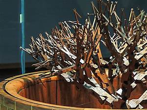 A tree of 511 interconnected pliers carved from a single for A tree of 511 carved wooden pliers