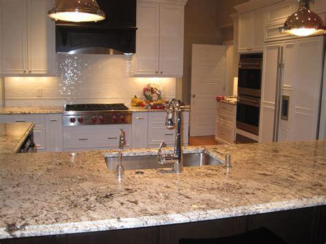 antico white granite bianco antico granite dark island with white perimeter cabinets visit globalgranite com for