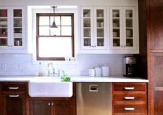 kitchen with tiles white cabinets with wood lowers white subway tile 3497