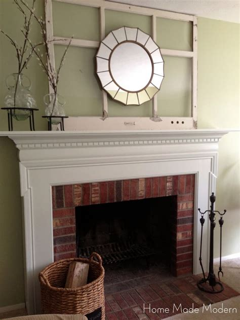 favored white painted fireplace mantel  brick wall