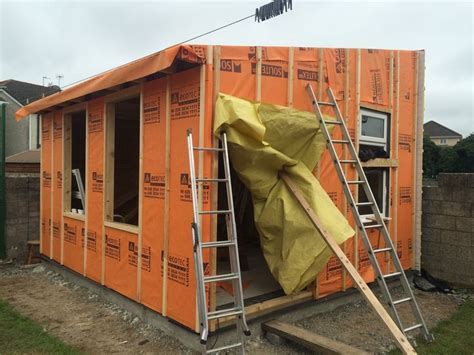 fitting shiplap cladding front and gable end walls battened and preped for fitting