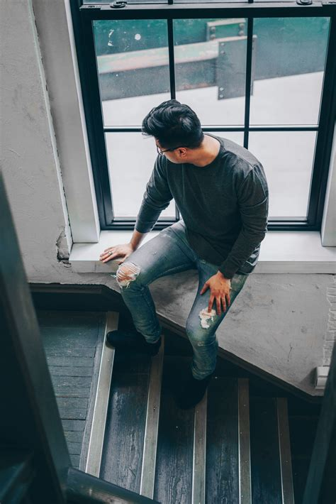 Man Sitting on a Concrete Stair Waiting for Someone during