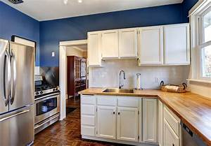 Cabinet painting and refinishing transform your kitchen for Kitchen colors with white cabinets with state of michigan wall art