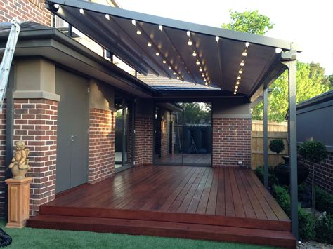 retractable pergola awning  quality design gray stained finish tough metal posts crossbeams