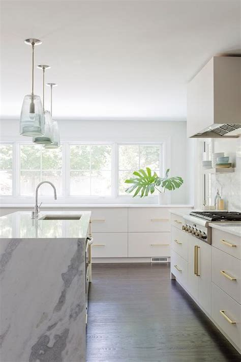 LIght Gray Kitchen Drawers with Brass Pulls   Contemporary