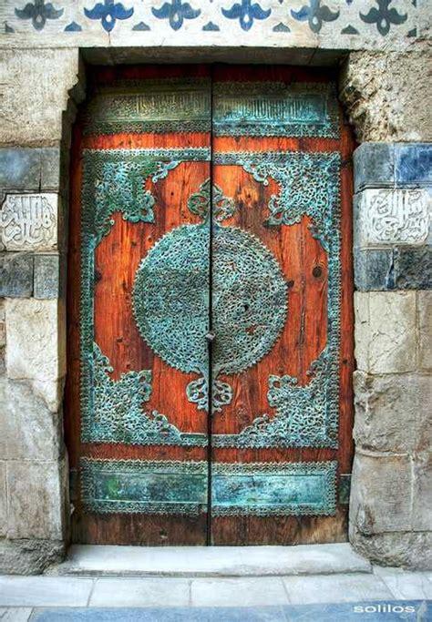antique metal  wood exterior doors bringing charm