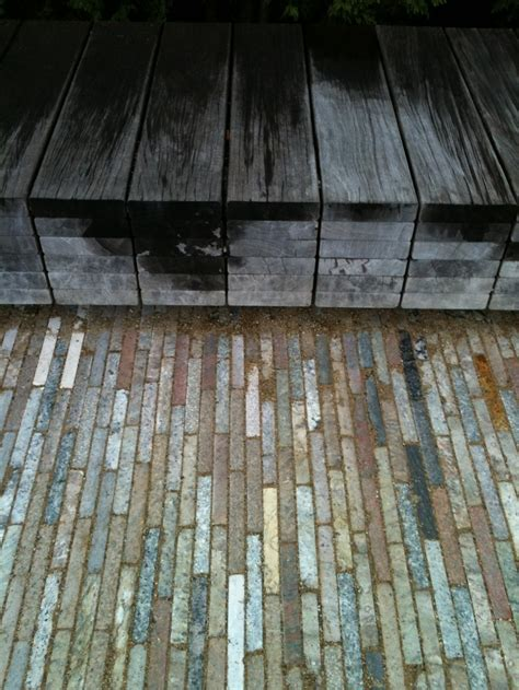 cool pavers against wood bench garden landscape design