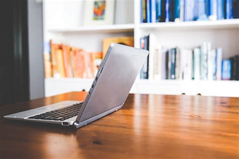 Laptop computer on a wooden desk · Free Stock Photo