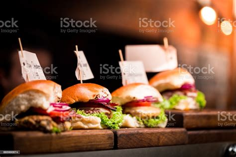 Fresh Flame Grilled Burgers Displayed In A Row At Food ...