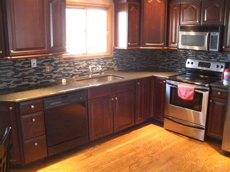 white cabinets black granite what color backsplash white granite on white kitchen cabinets perfect home design