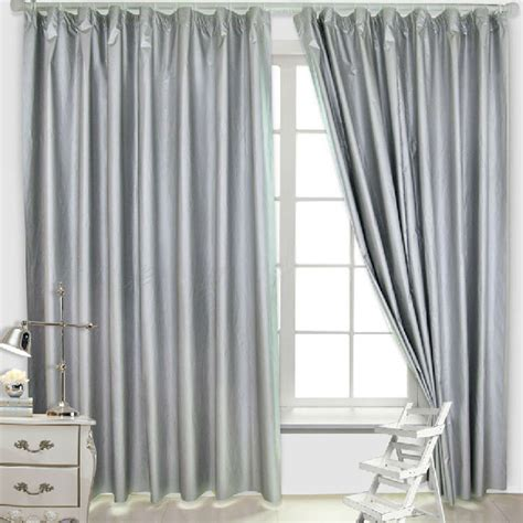 simple curtains in silver color is for blackout