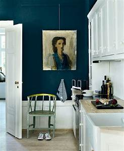 portrait on dark navy wall in kitchen for the home With kitchen cabinets lowes with navy and white wall art