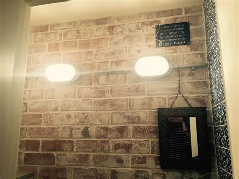 whitewashed exposed brick wall galvanised conduit lighting coughtrie stripped bulkheads