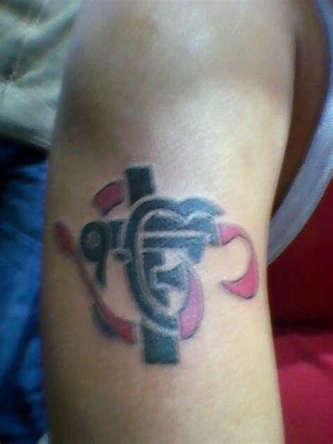 om ek onkar cross tattoo