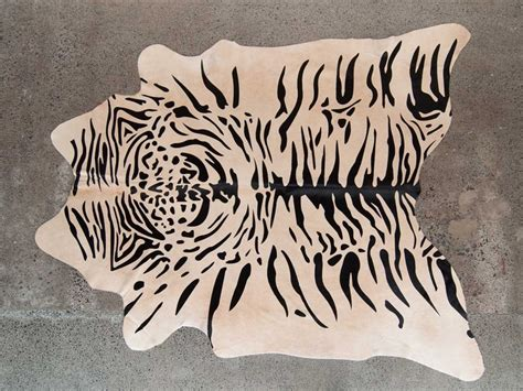 cowhide rugs nz 46 best images about cowhide rugs on ottomans