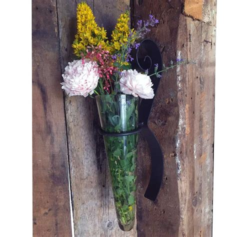 wall flower vase pictured here is the scroll wall flower glass vase from mathews and company