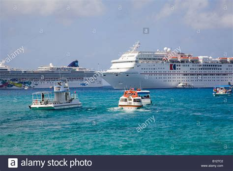 Cruise Ships Anchored Off Georgetown Grand Cayman Cayman Islands In Stock Photo Royalty Free ...