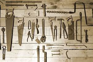 Old hand tools on workshop wall Stock Photo Colourbox